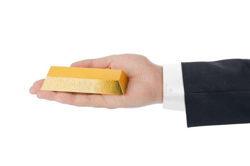 Hand met gouden bar stock foto's