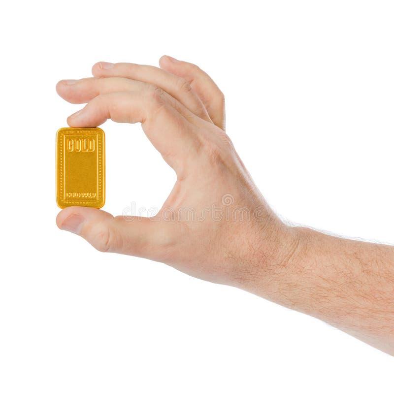 Hand met gouden bar stock foto