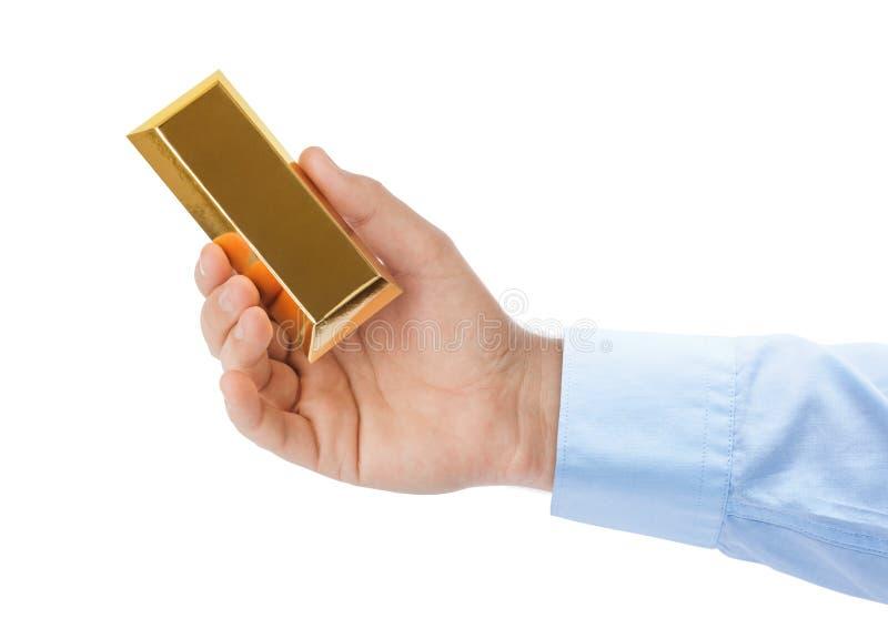 Hand met gouden bar stock afbeelding