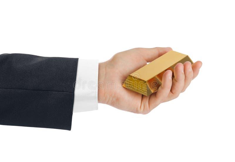 Hand met gouden bar royalty-vrije stock foto