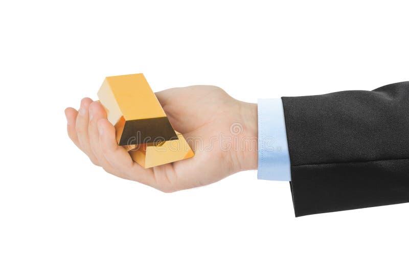 Hand met goudstaven stock afbeelding