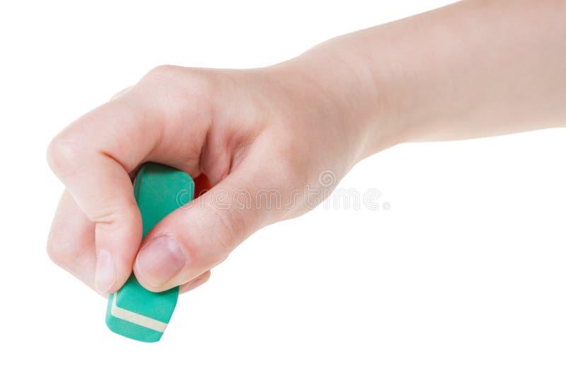 Hand met groene nieuwe rubbergom dichte omhooggaand royalty-vrije stock afbeelding