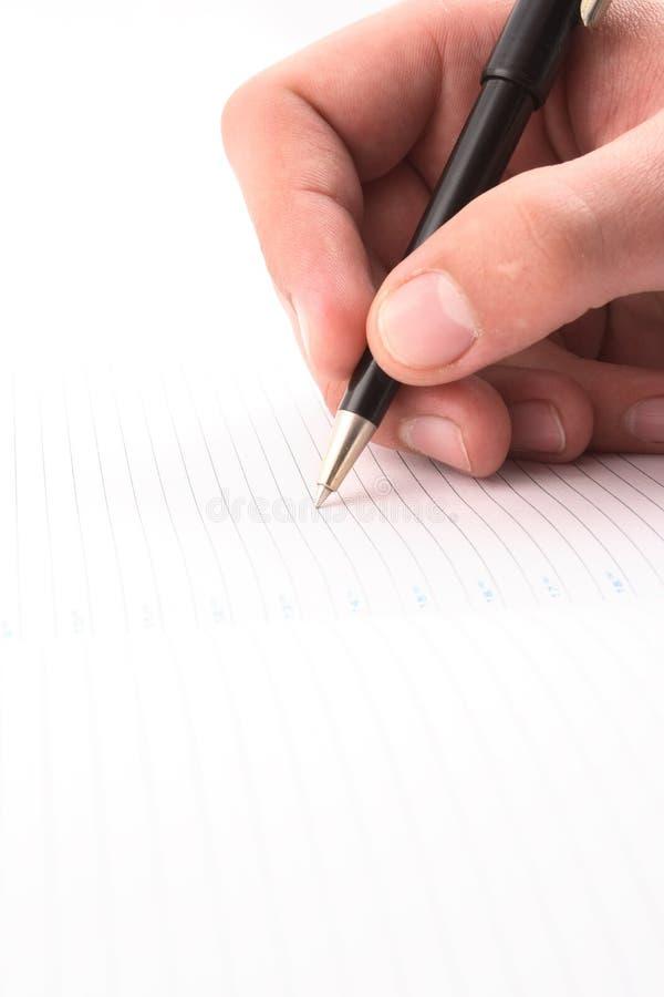 Hand met het handvat, dagelijks logboek, document stock fotografie