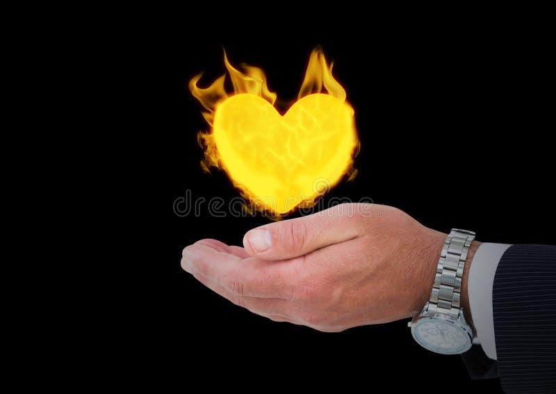 hand met het pictogram van de hartbrand over Zwarte achtergrond royalty-vrije stock afbeeldingen