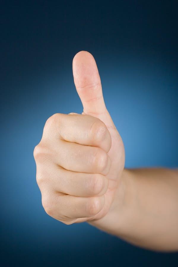 Hand met omhoog duim stock fotografie
