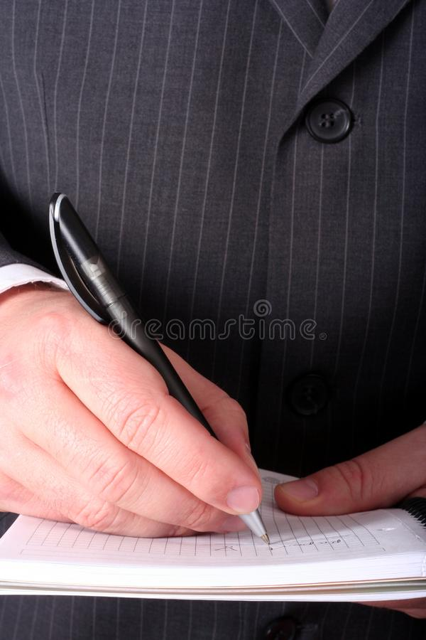 Hand met pen stock foto