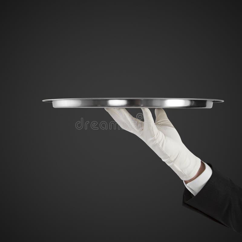 Hand met plaat stock fotografie