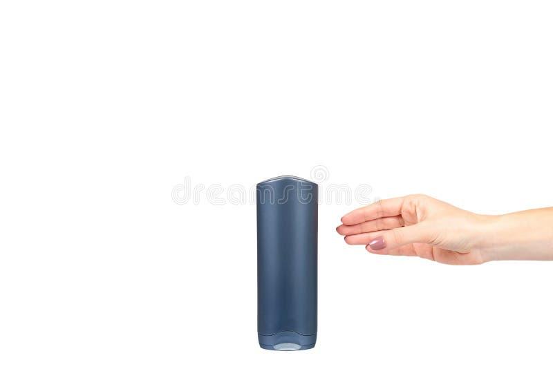 Hand met plastic kosmetische fles, shampoo en zeepgel stock foto's