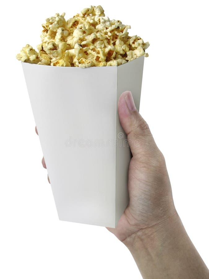 Hand met Popcorn, op witte achtergrond ter beschikking wordt geïsoleerd die royalty-vrije stock foto