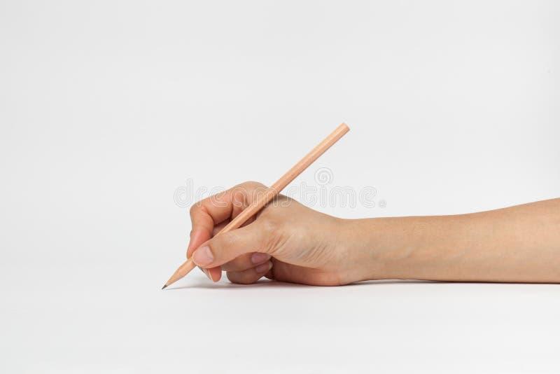 Hand met potlood die iets schrijven royalty-vrije stock afbeelding