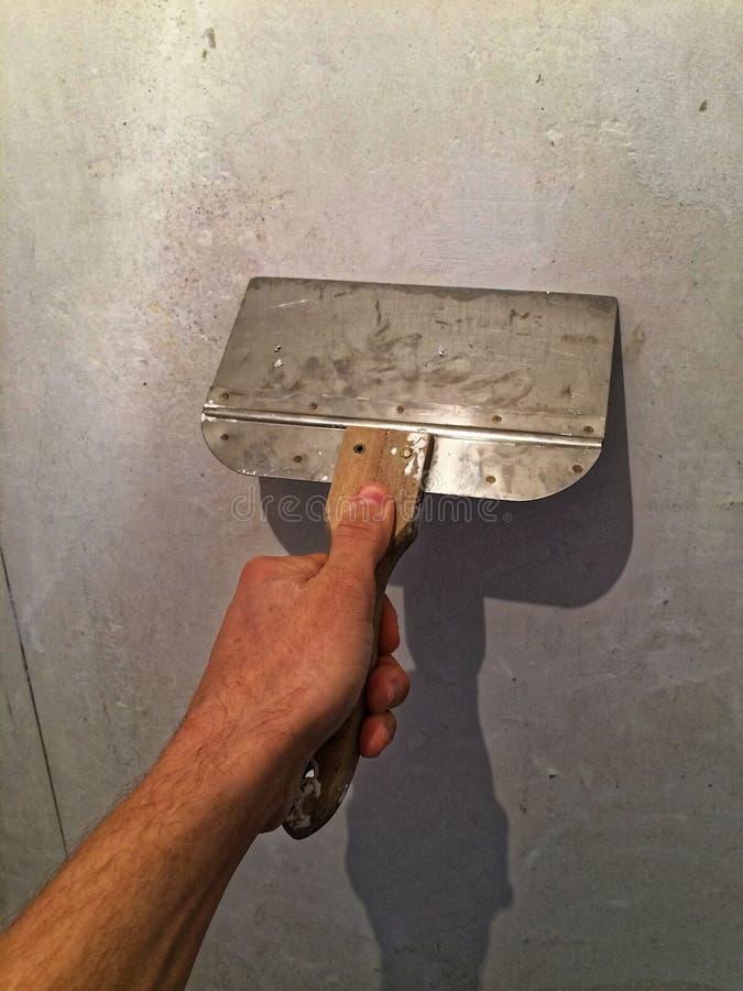 Hand met Schraper 02 stock afbeelding