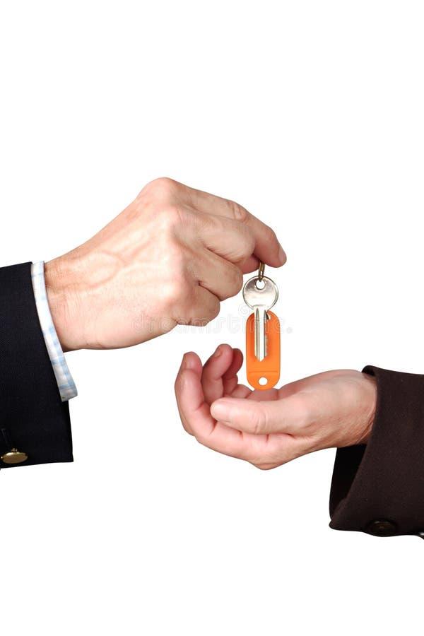 Hand met sleutel stock afbeeldingen
