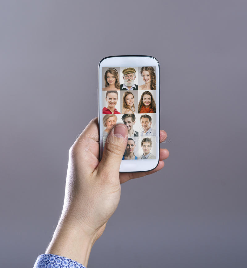 Hand met slimme telefoon stock afbeeldingen
