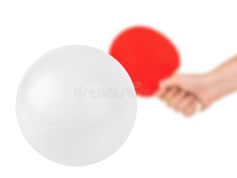 Hand met tennisracket en bal stock foto's