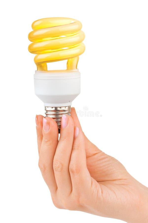 Hand met verlichtingslamp stock afbeelding