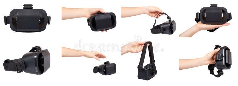 Hand met zwart plastic virtueel werkelijkheidsmasker, vr glazen, reeks en inzameling stock fotografie
