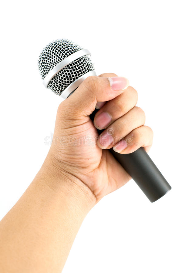 Hand with a microphone. Isolated on white stock image