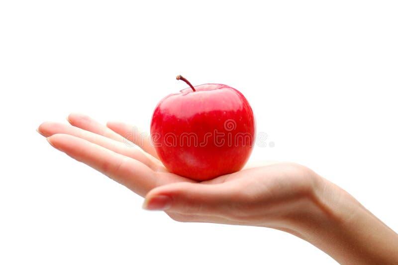 Hand mit Apfel stockfotos