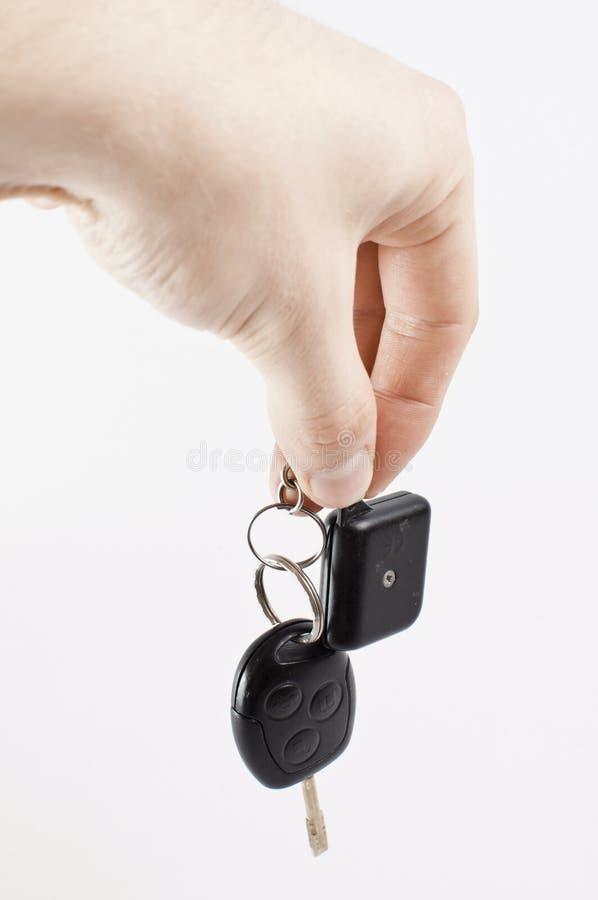 Hand mit Autotasten lizenzfreie stockfotos
