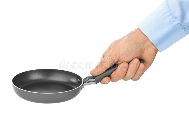 Hand mit Bratpfanne stockbild