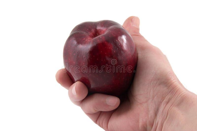 Hand mit einem Apfel stockfotos