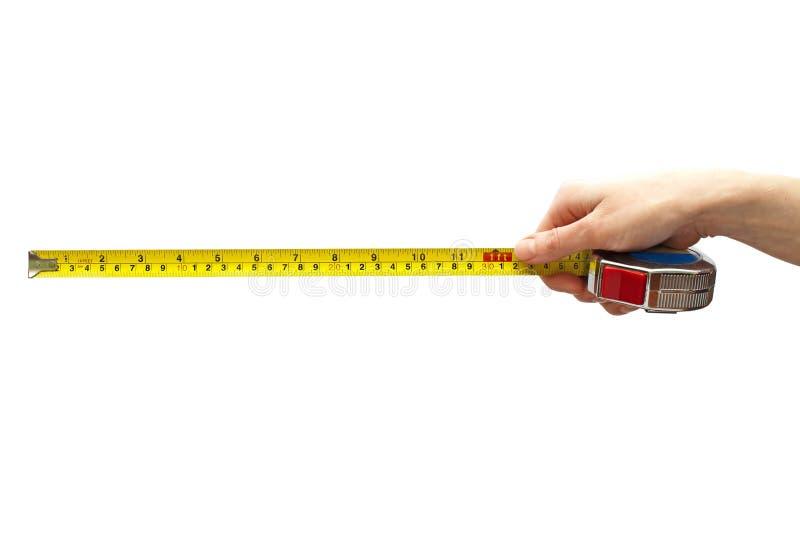 Hand mit einem messenden Band lizenzfreies stockfoto
