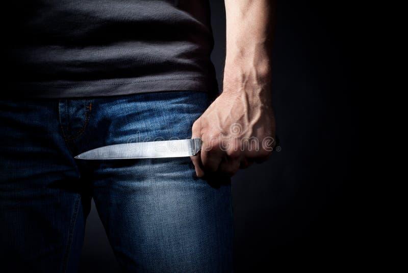 Hand mit einem Messer lizenzfreie stockfotos