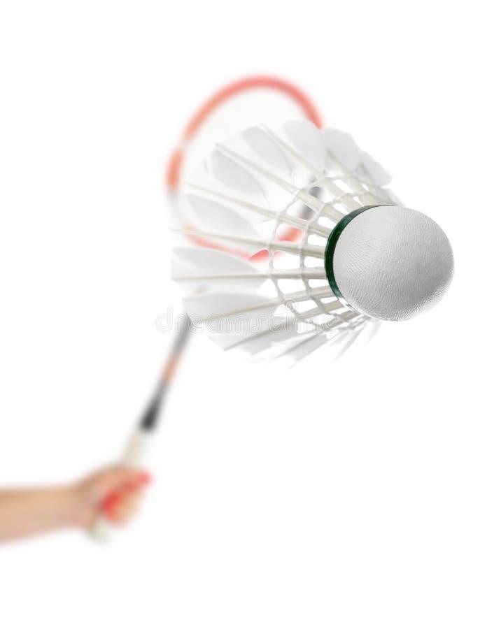 Hand mit Federballschläger und Federfederball stockfotos