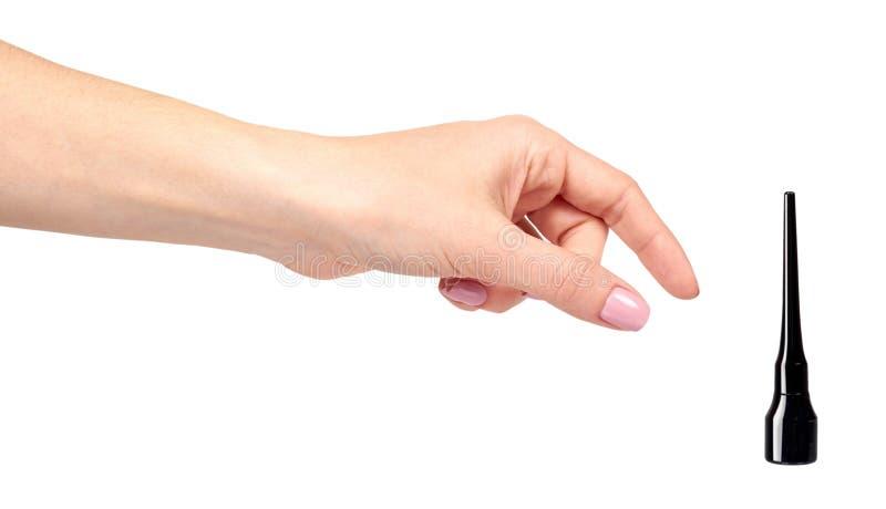 Hand mit Jauchebleistift, Augenmake-upbürste stockfoto