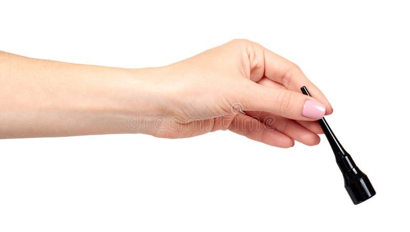 Hand mit Jauchebleistift, Augenmake-upbürste lizenzfreies stockbild