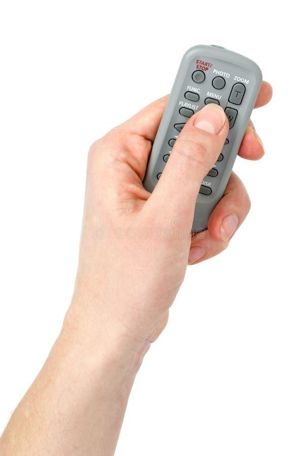 Hand mit kleiner Infrarotfernsteuerungsmaßeinheit stockbilder