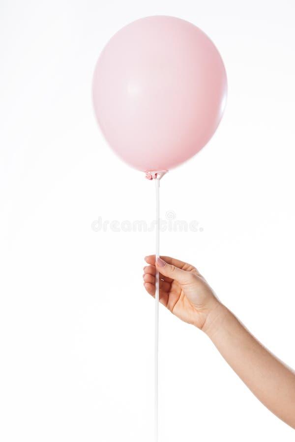 Hand mit rosa Ballon stockbilder