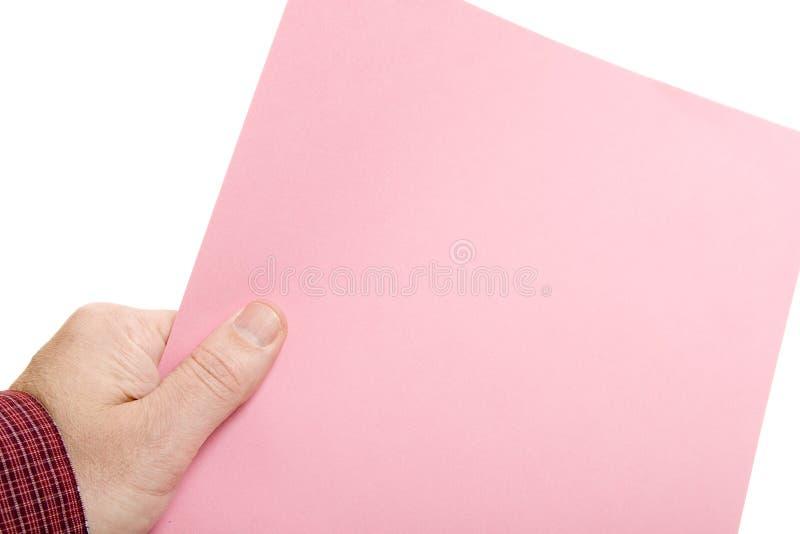 Hand mit rosafarbenem Beleg stockfotos