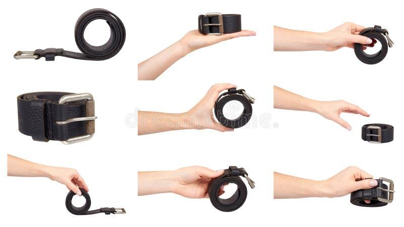Hand mit schwarzem Lederg?rtel, klassischem Zusatz, Satz und Sammlung stockfotografie