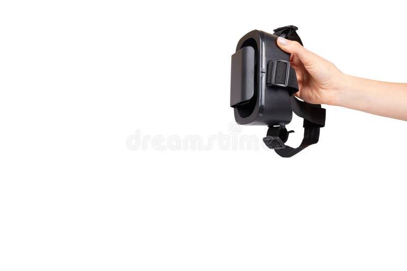 Hand mit schwarzem Plastik-VR-Kopfh?rer, Maske der virtuellen Realit?t stockfotos