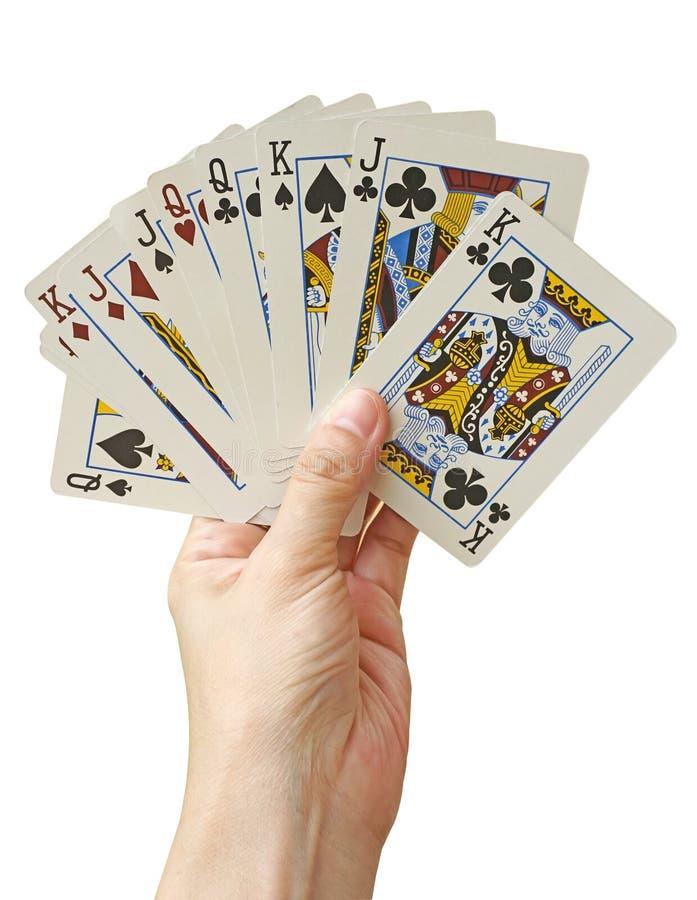 Hand mit Spielkarten, auf Weiß (Beschneidungspfad) stockfotografie