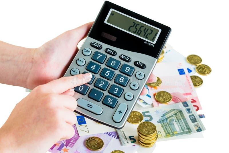 Hand mit Taschenrechner und Geld stockfotografie