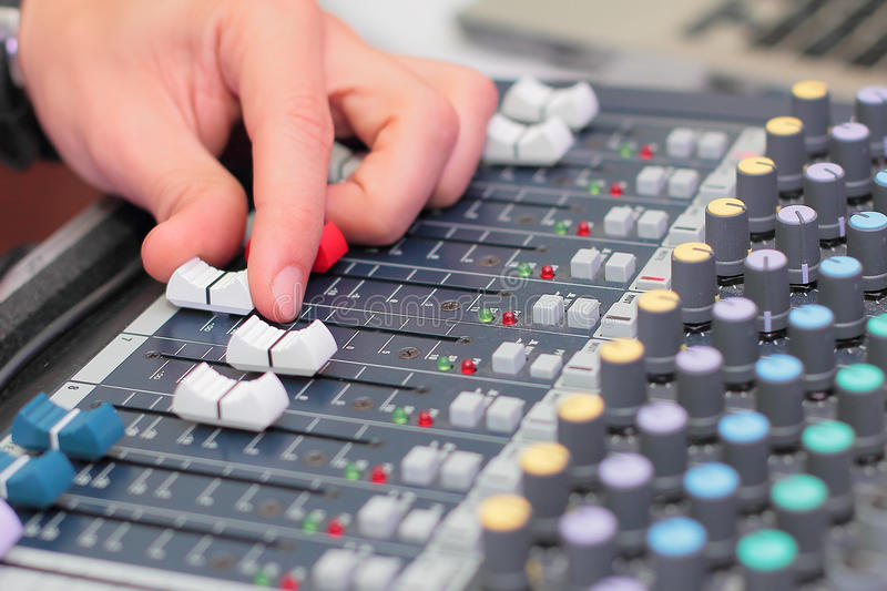 Hand on mixer. Sound producers hand on mixer royalty free stock photos