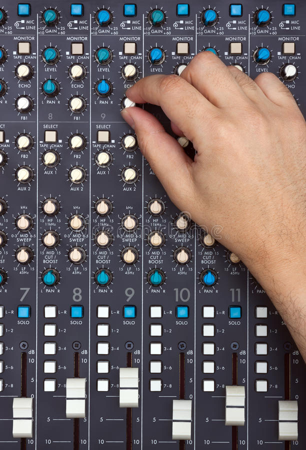 Hand on Mixing Desk stock image
