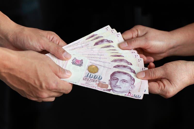 Hand with money stock photos