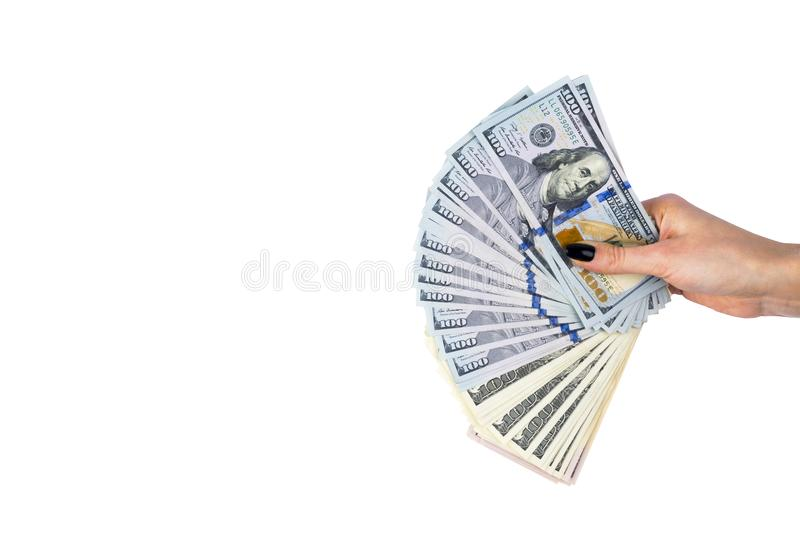 Hand with money isolated on white background. US Dollars in hand. Handful of money. Business woman offering money. Counting money stock photo