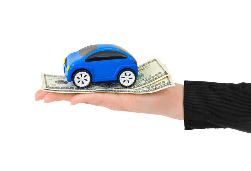 Hand with money and toy car. Isolated on white background stock images