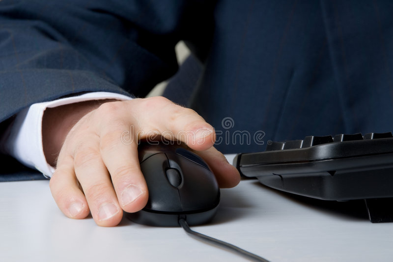 Hand on mouse stock photography