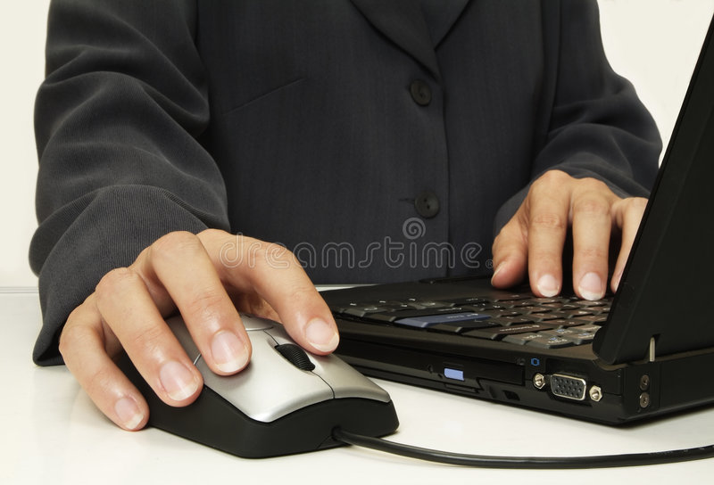 Hand on mouse. Corporate person using laptop & mouse close up