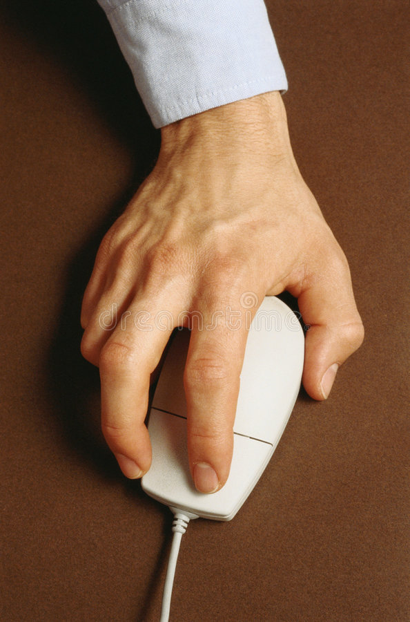 Hand with mouse pointing device. Work for computer royalty free stock images
