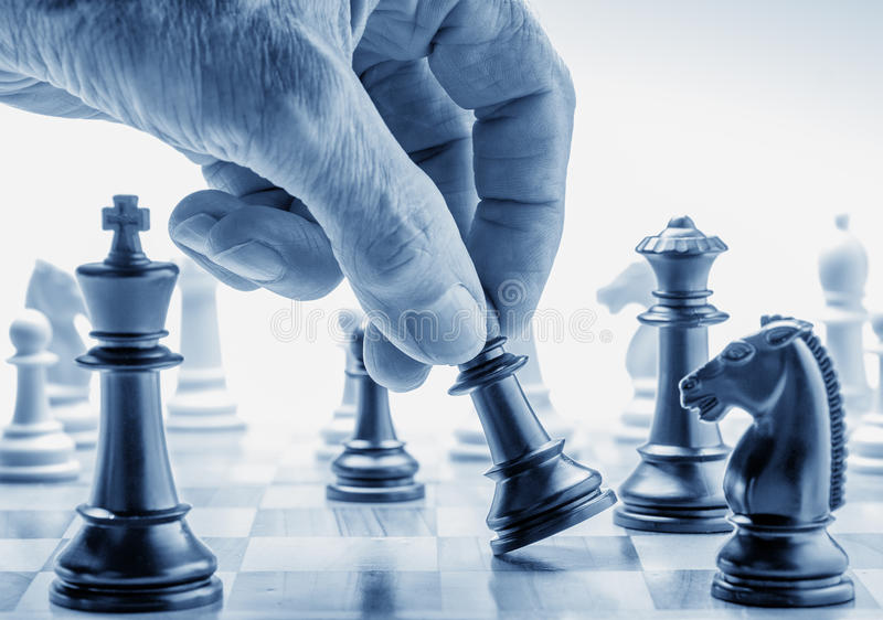 Download Hand Moving A Chess Piece On Board Stock Image - Image: 32311839