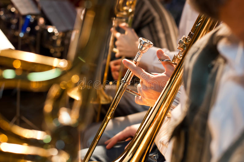 The hand of a musician holding a trombone. Closeup royalty free stock images