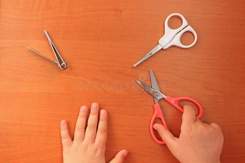 Hand and nail care for the child. Children`s manicure. View from above. stock image