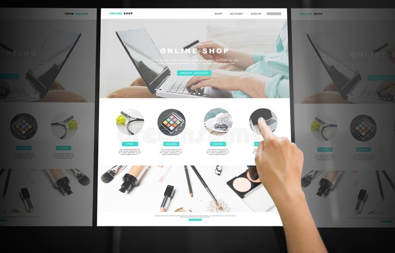 Hand navigating online shop on interactive panel stock photos