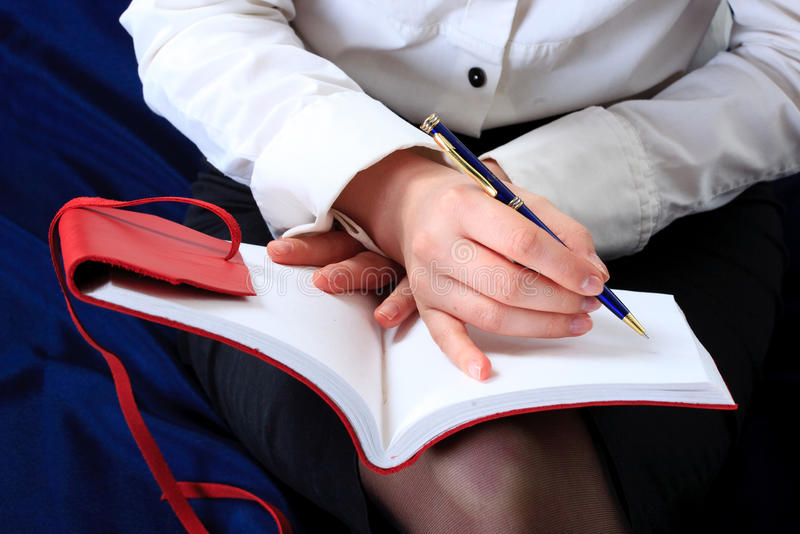 Hand and notebook. Close up royalty free stock image